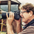 Foto de Stock  : Senior Photographer Happy to have found correct exposure