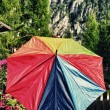 Multicolor Umbrellwith Dolomites Mountains Background — Stock Photo #12631422