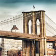 Portrait view of Brooklyn Bridge Tower and flag in New York City — Stock Photo #12632218
