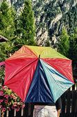 Multicolor Umbrella with Dolomites Mountains Background — Stock Photo