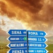 Road signs pointing different directions in Tuscany — Stock Photo