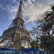 The Eiffel Tower in Paris shot against a blue winter sky — Stock Photo #13183156