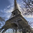 The Eiffel Tower in Paris shot against a blue winter sky - Stock Photo