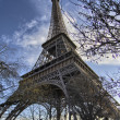The Eiffel Tower in Paris shot against a blue winter sky — Stock Photo #13183165