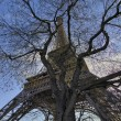 The Eiffel Tower in Paris shot against a blue winter sky — Stock Photo #13183245