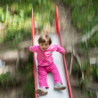 Stock Photo: Blurred movement of baby on Slide