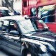 Motion blur picture of Black Cab and Red Double Decker Bus in th — Stock Photo #13585479