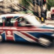 UK cab in London, Motion blur effect — Stock Photo