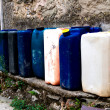 Row of colorful Jerry Cans on the street - Italy — Stock Photo