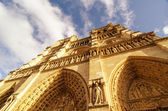 Upward street view of Notre Dame Cathedral in Paris — Stock Photo