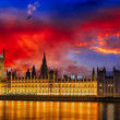 Red sky over Big Ben and House of Parliament at River Thames International Landmark of London England at Dusk - UK - Stock Photo