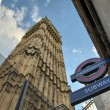 LONDON - SEP 27 : The 'Underground' sign and 'Big Ben' tower at — Stock Photo