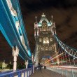 Detail of Tower Bridge in London at night with car light trail - — Stock Photo #13946864