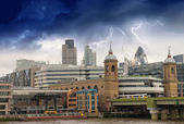 Storm over City of London, financial center and Canary Wharf at — Stock Photo