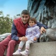 Stock Photo: Baby with father playing at the base of Nelson Column in Trafalg
