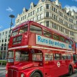 LONDON, SEP 28: Red double decker bus speeds up on the streets o - Stock Photo