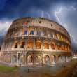 Beautiful dramatic sky over Colosseum in Rome - Stock Photo