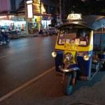 Bangkok: A three wheeled tuk tuk taxi on a street — Stock Photo #16324691