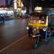 Stock Photo: Bangkok: three wheeled tuk tuk taxi on street