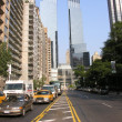 New York City: Taxi speeds up in downtown — Stock Photo #16325401