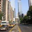 New York City: Taxi speeds up in downtown — Stock Photo