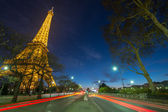 Wonderful colors of Eiffel Tower. Winter sunset with car light t — Stock Photo