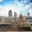 City of London with clouds, financial center and Canary Wharf at - Stock Photo