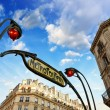 Stock Photo: Paris. Underground Metro sign with buildings and sunset colors