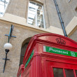 Red Telephone Booth on a classic London Street — Stock Photo #18147721