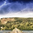 Stock Photo: Beautiful road on lake with storm colors