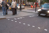 Motion blur picture of Black Taxi approaching Look Right sign — 图库照片