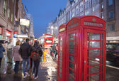 Red Telephone Booth on a classic London Street — Stock Photo