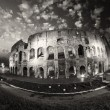 Dramatic sky above Colosseum in Rome. Night view of Flavian Amph - ストック写真