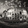 Dramatic sky above Colosseum in Rome. Night view of Flavian Amph - Стоковая фотография