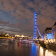 London Eye - dramatic night shot with full Thames and Buildings — Stock Photo