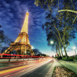 PARIS - DEC 1: Eiffel Tower shows its wonderful lights at sunset — Stock Photo #19396059