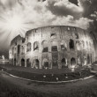 Dramatic sky above Colosseum in Rome. Night view of Flavian Amph — Foto de Stock