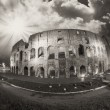 Dramatic sky above Colosseum in Rome. Night view of Flavian Amph — ストック写真