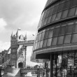 City Hall on the banks of the Thames with Tower Bridge, London U - Stock Photo