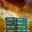 Road signs pointing different directions in Tuscany — Stock Photo #19449553