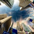 Dramatic Sky above Giant Skyscrapers, fisheye view - Stock Photo