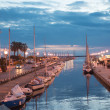 Sunset in Viareggio, Italy. Beautiful promenade with channel and — Stock Photo