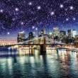 amazing night in new york city - stars above skyscrapers — Stock Photo