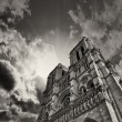 Awesome upward view of Notre Dame Cathedral with dramatic sky — Stock Photo