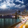 Amazing New York Cityscape - Skyscrapers and Brooklyn Bridge at - Stock Photo