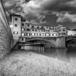 Ponte Vecchio over Arno River, Florence, Italy. Beautiful black - Stock Photo