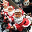 Royalty-Free Stock Photo: Group of Santas in a Italian Shop