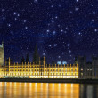 Stars over Big Ben and House of Parliament - Starry night in London - Stock Photo