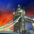 London, The Tower Bridge lights show at sunset — Stock Photo