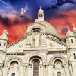 Beautiful sunset colors over Sacred Heart Cathedral in Montmartre - Stock fotografie